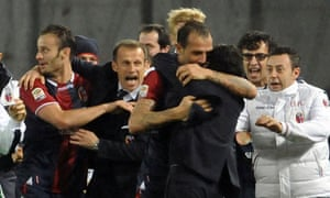 Bologna's players and team staff celebrate after Daniele Portanova scored the winner.