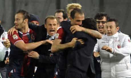 Bologna's players and team staff celebrate after Daniele Portanova scored the winner.