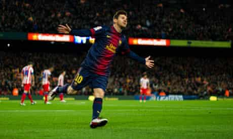 Lionel Messi celebrates scoring Barcelona's third goal