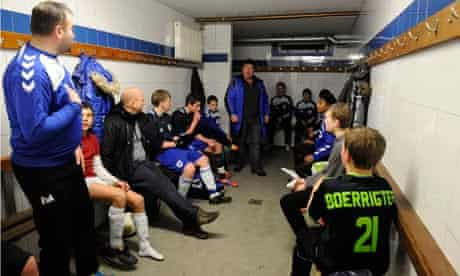 Boys and coaches in one of the changing rooms at SC Buitenboys