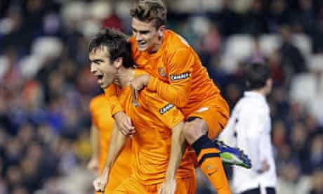 Real Sociedad's Mikel Gonzalez celebrates with Antoine Griezmann after scoring their team's second