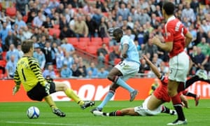 Manchester City's Yaya Touré, centre, scores the winner against United in the 2011 FA Cup semi-final