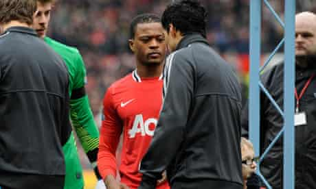 Luis Suarez refuses to shake hands with Patrice Evra