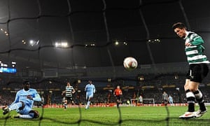 Sporting Lisbon's Ricky van Wolfswinkel scores in the Europa League match at Manchester City