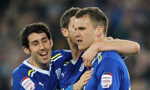 Cardiff City players celebrate the own goal scored by Cody McDonald of Coventry City