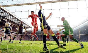 Luis Suárez of Liverpool gets the ball in the Wigan Athletic net but the goal was disallowed