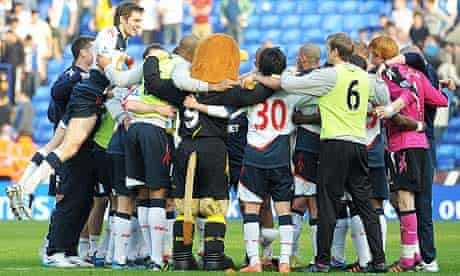 Bolton Wanderers huddle after win against Blackburn Rovers, a week after Fabrice Muamba's collapse