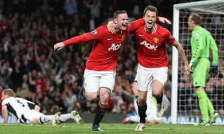 Wayne Rooney celebrates with Jonny Evans after scoring for Manchester United against Fulham.