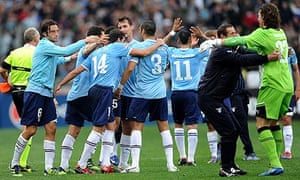 Lazio's players celebrate after the game