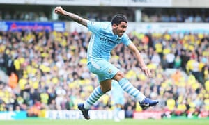Manchester City's Carlos Tevez puts his side 1-0 up in their Premier League win at Norwich City