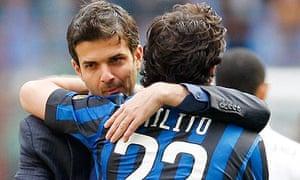 Andrea Stramaccioni celebrates with Diego Milito at the final whistle