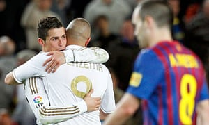 Cristiano Ronaldo is congratulated by Karim Benzema as they celebrate victory over Barcelona