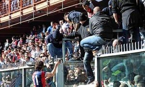 Genoa's Giuseppe Sculli talks to supporters during the match
