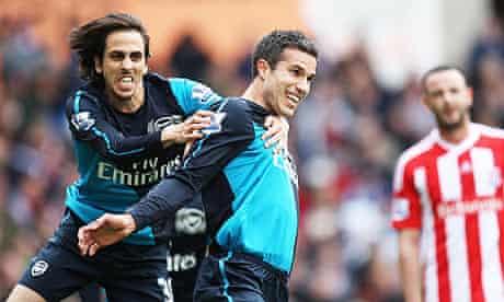Arsenal's Robin van Persie celebrates scoring against Stoke City
