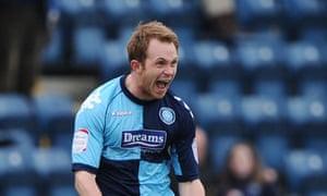 Wycombe Wanderers' Stuart Lewis after scoring against Carlisle United