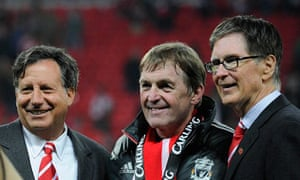 Kenny Dalglish flanked by Liverpool's chairman, Tom Werner, and John W Henry
