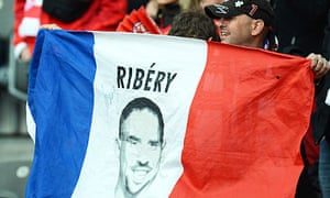 A Bayern Munich fan shows his support for the France midfielder Franck Ribéry, a threat to Chelsea