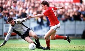 England's Chris Waddle takes on Aylesbury goalkeeper Tim Garner during their 1988 friendly
