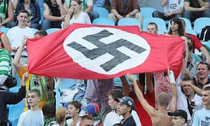 Supporters of Karpaty Lviv hold a Nazi flag with a swastika at a match against Dynamo Kyiv in 2007