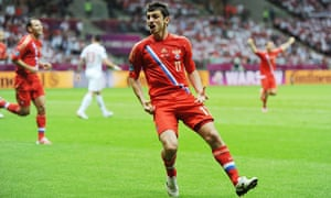 Alan Dzagoev celebrates scoring for Russia