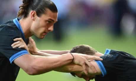 Andy Carroll, left, of Liverpool and England