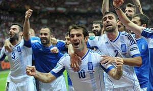 Greece's Giorgos Karagounis, foreground, and team-mates