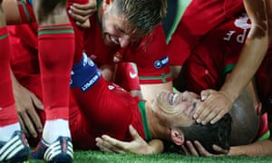 Cristiano Ronaldo is mobbed by team-mates