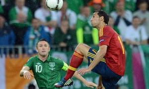 Alvaro Arbeloa clears from Robbie Keane