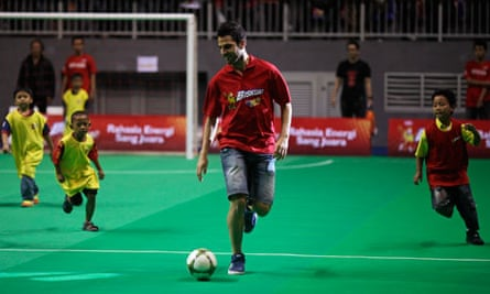 Cesc Fabregas plays futsal with a children's team during a promotional event in Jakarta this week