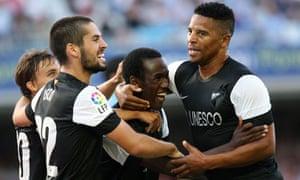 Malaga CF's forward Fabrice Olinga (C) c