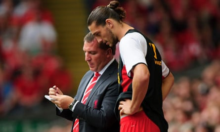 Andy Carroll, right, and Brendan Rodgers of Liverpool
