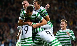 Celtic's Gary Hooper is smothered by team-mates as they celebrate his goal against Helsingborg.
