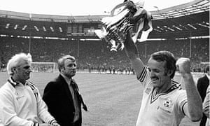 Southampton captain Peter Rodrigues lifts the FA Cup in 1976