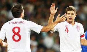 England's Frank Lampard, left, celebrates with Steven Gerrard after scoring against Moldova.