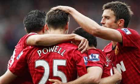 Nick Powell, centre, of Manchester United celebrates with a group hug