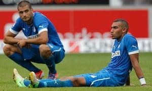 Hoffenheim's Daniel Williams, right, and Eren Derdiyok after their 4-0 beating