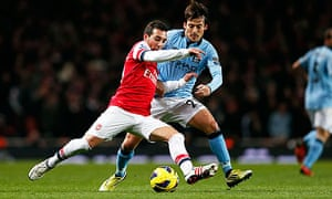 David Silva close down Santi Cazorla during Manchester City's win over Arsenal at the Emirates.