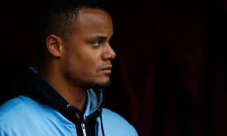 Vincent Kompany watches on after going off injured in the win at Stoke