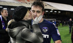 Oldham's Jose Baxter is kissed by a fan after the win over Liverpool