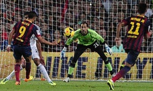 Barcelona's Alexis Sánchez scores against Real Madrid