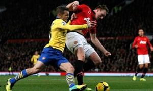 Arsenal's Wilshere challenges Manchester United's Phil Jones