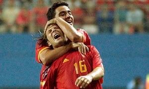 Xavi hugs Spain team-mate Gaizka Mendieta during the 2002 World Cup