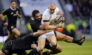 Mike Brown attempts to break through the New Zealand defence during England's autumn international