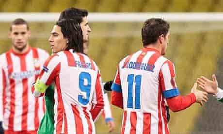 Atlético Madrid's goalscorer Radamel Falcao congratulates a Rubin Kazan player