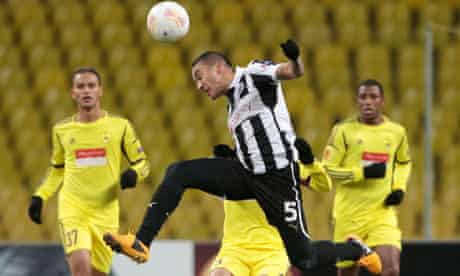 Newcastle's Danny Simpson heads the ball during the Europa League first leg against Anzhi