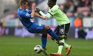 Callum McManaman of Wigan tackles Massadio Haidara