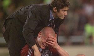Bayern Munich's Carsten Jancker is consoled by Bixente Lizarazu
