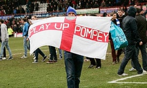 A Portsmouth fan with a flag