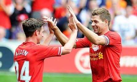 Liverpool's Steven Gerrard congratulates Joe Allen on opening the scoring against Olympiakos