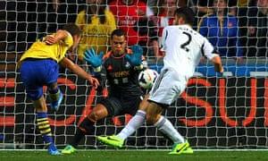 Arsenal's Aaron Ramsey scores past Swansea City's goalkeeper Miche Vorm